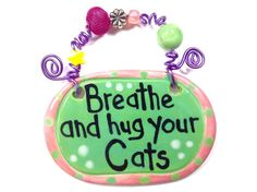 Breathe and hug your cats green ceramic sign by showmealittlesign