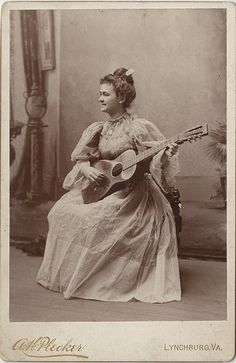 A lovely Victorian musician posing for a studio portrait. #Victorian #portrait #musician