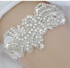 A personal favorite from my Etsy shop https://www.etsy.com/listing/264478809/wedding-garter-garter-with-rhinestone