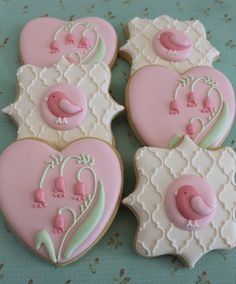 Sugar cookies With Pastel Royal Icing Birds, Flowers with Voile Background.