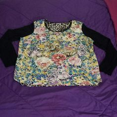 Floral/Tiger Graphic Long-sleeved Top NWOT! IN PERFECT CONDITION! Super cute graphic top from Jaclyn Smith. Back of top is cheeta print! Sleeves are soft fabric while the graphic part of the top is more of a silk. Has scoop neck with adorable faux leather and flat stud detail! BRAND: Jaclyn Smith SIZE: XXL  Always ask any questions you may have! Thank you :) Jaclyn Smith Tops Tees - Long Sleeve