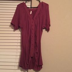 Pink shirt Gently used pink shirt with buttons. Very cute and hides problem stomach areas!! Xhilaration Tops Blouses