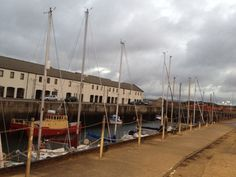 Sheds at the harbour at Lossiemouth. Fishing is an occupation. Jesus called his disciples to be fishers of men.