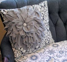 I saw a pillow very similar to this in a designer showroom, except little of the backing fabric showed. A must-have!