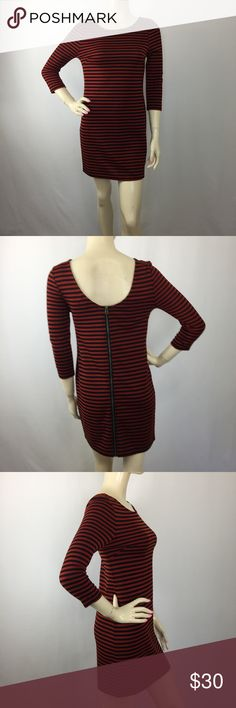 """⚫️ Criss Cross Striped Orange & black dress Small 💖💖💖CHECK OUT MY OTHER ITEMS THAT I HAVE LISTED AT A GOOD PRICE, I ADD NEW LISTINGS DAILY!!!!💖💖💖  MEASUREMENTS: (Please note that the measurements are approximate. ALL MEASUREMENTS ARE TAKEN WITH GARMENT LYING FLAT: SLEEVES: 18"""" BUST: 15.5"""" WAIST: 15"""" HIPS: 17"""" LENGHT: 32"""" Criss Cross Dresses"""