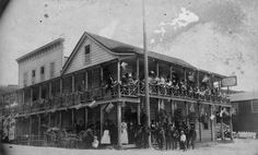 (ca. 1898)* - Group portrait of people standing on the ground floor and along the balcony of the second floor of the San Pedro Hotel. Many f...