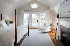 Browse the exterior and interior images of Rural Vineyard located in historic Edgartown, Martha& Vineyard. The property includes the main home, an attached carriage house, and extensive outdoor living spaces including a pool area and pool cabana. Discount Bedroom Furniture, Bedroom Arrangement, Bedroom Fireplace, White Curtains, White Paneling, Decoration, Furniture Decor, Furniture Design, Bedroom Decor