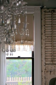 frame a window with old shutters.  Trim a standard window shade with burlap trim and buttons!!