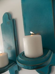 Guest bathroom- deep teal candle sconces - I have similar sconces like this that are mirrored that my father made.
