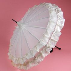 pretty white umbrella with ruffles