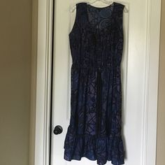 Banana Republic Sleeveless Dress A beautiful lightweight dress done in purple and deep blues and black patterns. There is a drawstring waist detail and black buttons down the middle of a mini pleated top. This dress looks very flattering on. It was only worn a few times. Banana Republic Dresses Midi