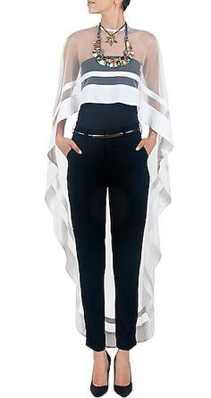 Nikhil Thampi presents White Asymmetrical net cape available only at Pernia's Pop-Up Shop. Fashion Mode, Look Fashion, Hijab Fashion, Fashion Dresses, Womens Fashion, Fashion Design, Fashion Trends, 80s Fashion, Winter Fashion