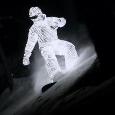 Snowboarder William Hughes glides down through the French snow in a gleaming L.E.D. suit. Perfect!