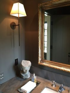 Love the side-mounted sconce in this powder room. A Gracious Houston Home | La Dolce Vita