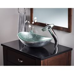 Novatto Argento Silver Tempered Glass Vessel Oval Bathroom Sink at Lowe's. Add a little design and harmony to your bath with Novatto's silver foiled glass vessel and matching chrome waterfall faucet. This oval sink features a Glass Basin, Glass Vessel Sinks, Undermount Bathroom Sink, Bathroom Sinks, Bathrooms, Bathroom Ideas, Downstairs Bathroom, Simple Bathroom, Bathroom Shelves