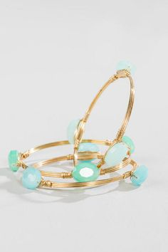 """Mint stone style beads are featured on these wire wrapped bangles.<br /> <br /> - set of 3<br /> - 2.75"""" diameter<br /> - Lead & Nickel free<br /> - Imported"""