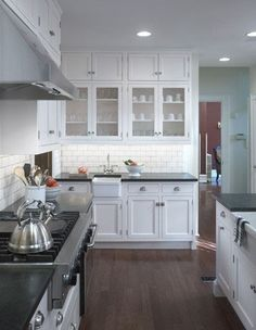 My classic kitchen would have brown wood floors and white brand new cabinets.