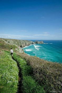 Porthcurno Beach, Cornwall, England - with the tide in! The Logan Rock in the background. As seen from the S. Places To Travel, Places To See, St Just, Devon And Cornwall, England And Scotland, English Countryside, Beautiful Beaches, Great Britain, Beautiful Landscapes