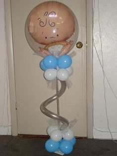 Ready to pop!  Baby centerpiece. www.balloonatics.info
