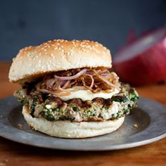 These #turkey #burgers are *actually* flavorful - filled with spinach, herbed goat cheese, caramelized onions and Dijon mustard.
