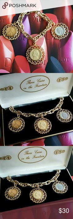 """1960's Three Coins in The Fountain Bracelet Goldtone, 7 and 1/2"""" long bracelet (fits small to medium size wrist), features three American coins, set in gold tone metal bezels, in a pattern of open hearts, double rope design, with each of the links scored to resemble twisted rope.?One coin is a Liberty 1966 dime, 1964 Liberty nickel, and 1944 copper penny. Very good to excellent vintage condition. Comes in the original box. Signed W.L.P. Vintage Jewelry Bracelets"""