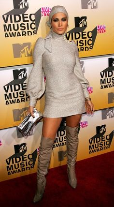 Jennifer Lopez Sweater Dress Jennifer Lopez sparkled at the 2006 MTV Video Music Awards in a glittery gold turtleneck sweater dress.