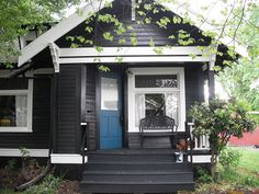 Black with white trim and bright blue door. Unexpectedly beautiful. From Barry Newman, LLC on Flickr.