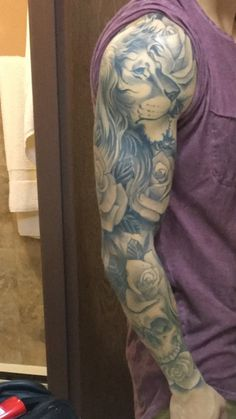 Full lion tattoo sleeve with roses and skull