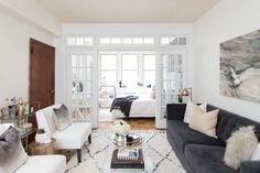 """A mix of calm, relaxing and """"adult"""" living room: http://www.stylemepretty.com/living/2016/09/08/from-empty-apartment-to-killer-bachelorette-pad-for-under-5k/ Photography: Laura Metzler - http://www.laurametzler.com/"""