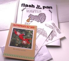 """fireflygirl777 (Margaret) says, """"I got these wonderful items ( Flash in the Pan cookbook and a cool elf card with pictures to color) and hope you will post them with the others...I did not expect any Shenanigans as I was too busy with prizes and hippos and any other event would have scrambled what is left of my brain! I love the generosity of the group!"""""""