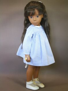I had a doll just like this one as a child. She was my favorite. I thought she was the most beautiful doll I had ever seen ! :)