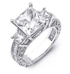R1054  18K White Ring. 0.15ct Round Brilliant pave diamonds, 0.44ct Princess on shoulders and 0.80ct Princess on sides. Center stone comes in different sizes 1.0ct to 2.0ct.