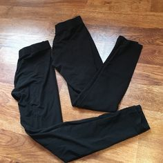 2 pairs of Lou & grey leggings Size small and medium but fit pretty much the same. They are faded from use. Can sell desperate for $7 or $10 for both pairs Lou & Grey Pants Leggings