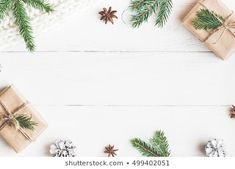 Christmas gift, knitted blanket, pine cones, fir branches on wooden white background. Noel Christmas, Christmas Photos, Winter Christmas, Christmas Gifts, Christmas Decor, Xmas, Christmas Background Images, Background Ideas, Wooden Background