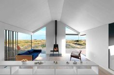 Beautiful, clean, white, modern living room with free standing fireplace and view. By Guy Hollaway.