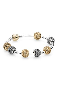 Go for a sophisticated ethnic boho-chic look by wearing Tropicana Openwork charms in gold and silver on your two-tone bangle bracelet. #PANDORA #PANDORAbracelet