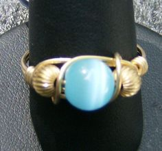 Wire Wrapped Ring - Handmade, Robin's Egg Blue Cat's Eye with Gold, Corrugated Gold Beads, Size 10 by JewelryArtistry - R309 - pinned by pin4etsy.com