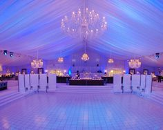Simply beautiful. I love the draped ceiling, the chandeliers, the blue lighting, the tiled dance floor, everything :)