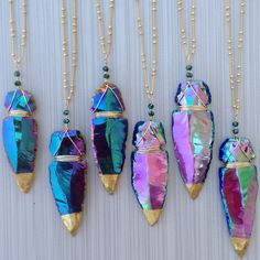 Large titanium arrowhead. Titanium peacock and titanium pink opal aura available. Limited quantity. 24k gold leaf tip on a 29inch long 16k gold plated chain. The colors in person are amazing. One of a kind. These are very hard for me to get so there may be a chance they would be temporarily unava...