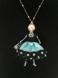 Meet Ellie's Belle, Lesley. French doll pendant elegantly dressed in a Tiffany blue taffeta skirt.