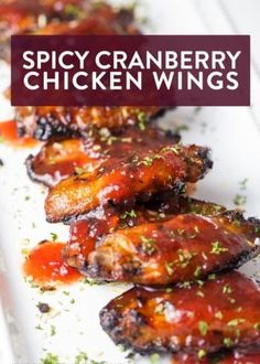 These spicy cranberry chicken wings are the perfect appetizer for Christmas parties, game days, and easy weeknight dinners. They're sweet, spicy, and easy to throw together at the last minute!