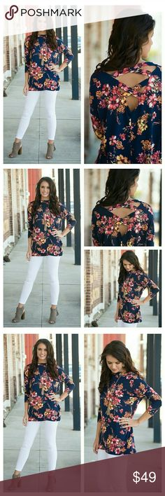 "JUST ARRIVED 🌻 Navy Floral Cross Back Tunic Chic Navy Floral Cross Back Tunic comfortable with  soft knit feel. Features 3/4 sleeves, cutouts around front neckline into strappy backside.   Super soft and comfortable with flattering design.   95% polyester 5% spandex   BUST: S-22.5"", M-23.5"", L-24.5""  LENGTH: S-27.5"", M-28.5"", L-29.5""  Oversized fit S (4/6) M (8/10) L (12/14) Infinity Raine Tops Tunics"