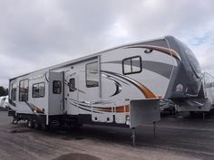 Life on the road is easy in a new Cyclone Toy Hauler like this! www.lakeshore-rv.com