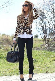 Shop this look on Lookastic:  http://lookastic.com/women/looks/sunglasses-cardigan-belt-dress-shirt-skinny-jeans-pumps-duffle-bag/5537  — Black Sunglasses  — Tan Leopard Cardigan  — Black Leather Belt  — White Dress Shirt  — Black Skinny Jeans  — Black Leather Pumps  — Black Leather Duffle Bag