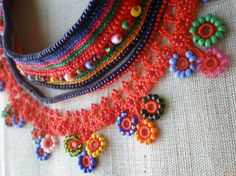 incredibly detailed crochet beaded necklaces.  Beautiful!