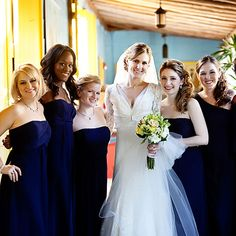 Bridesmaids wore dark blue Priscilla of Boston dresses in styles they selected themselves. Vue Photography.