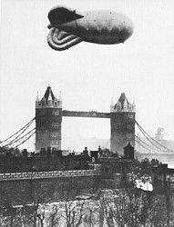 Looking across Tower of London towards Tower Bridge, Barrage Balloon jn foreground Blitz Tattoo, London Poster, The Blitz, London Architecture, London History, Air Raid, Battle Of Britain, Tower Of London, Luftwaffe