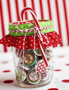 Christmas craft 1.Get old bottle caps and paint Christmas items on them 2.get a glass jar and put the caps in them  3.secure it and add ribbons of your choice and decorate it with hard candies  * don't eat candies once they have glue on them!*