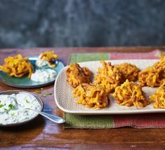 Cook crispy onion bhajis with cooling cucumber and mint raita as a snack, or alongside a homemade Indian curry. You may be surprised how easy they are to make Bbc Good Food Recipes, Easy Dinner Recipes, Indian Food Recipes, Indian Foods, Dinner Ideas, Healthy Chicken Recipes, Diet Recipes, Cooking Recipes, Savoury Recipes