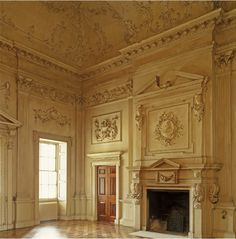 The baroque entrance hall at Trafalgar Park. The fine plasterwork includes a bust of Inigo Jones over the chimneypiece,18th century Georgian style, Wiltshire, England.